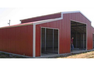 Red Metal Barn with white trim
