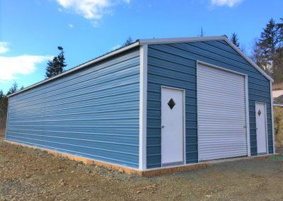 Metal Garage, blue with white trim, diamond windows on the side doors