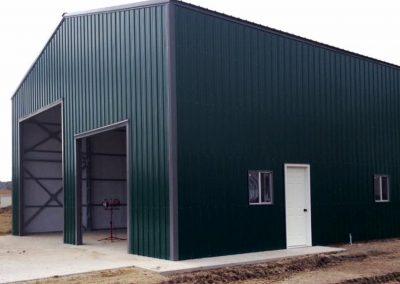 Green Metal Garage with gray trim